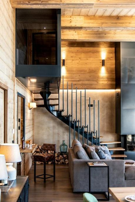 escalier métal chalet contemporain cheminée acier brut noir mat appartement luxe Les Arcs