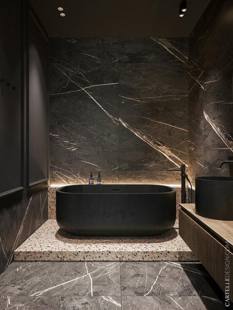 salle de bain noire baignoire ilot marbre noir sol terrazzo rose - clem around the corner