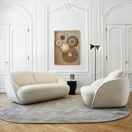canapé arrondi tapis rond oval salon mise en valeur aménagement intérieur