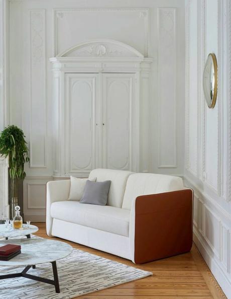canapé convertible bicolore blanc rouge cuir appartement parisien