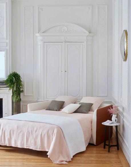 canapé convertible bicolore blanc rouge cuir appartement parquet bois